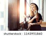 blonde long hair female artist... | Shutterstock . vector #1143951860