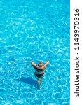 woman relaxing in infinity pool ... | Shutterstock . vector #1143970316