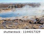 strokkur geyser at the geysir...   Shutterstock . vector #1144017329