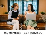two professional women have a... | Shutterstock . vector #1144082630