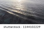 aerial drone video of surfers... | Shutterstock . vector #1144102229