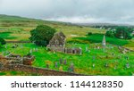 ruins of an old church and... | Shutterstock . vector #1144128350