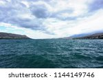 dramatic sky and waves on the... | Shutterstock . vector #1144149746