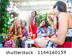 multiethnic group of friends... | Shutterstock . vector #1144160159
