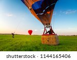 hot air balloon landing | Shutterstock . vector #1144165406