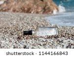 closeup of a glass bottle...   Shutterstock . vector #1144166843