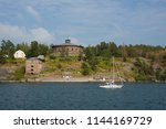 sail boat and old fortress... | Shutterstock . vector #1144169729