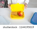 the schoolboy holding a yellow... | Shutterstock . vector #1144195019