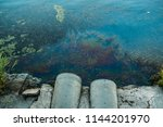 sewer pipes at shore  stain of... | Shutterstock . vector #1144201970
