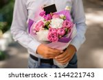 boy in white shirt holding a... | Shutterstock . vector #1144221743
