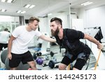 young bearded man doing... | Shutterstock . vector #1144245173