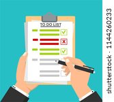 hand filling checklist on to do ... | Shutterstock .eps vector #1144260233