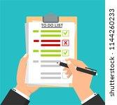 hand filling checklist on to do ... | Shutterstock .eps vector #1144260233