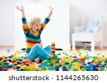 child playing with colorful toy ... | Shutterstock . vector #1144265630
