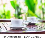 close up white coffee cup put... | Shutterstock . vector #1144267880