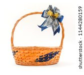 empty wood basket with bow... | Shutterstock . vector #1144280159