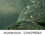 wet edge of powerful waterfall | Shutterstock . vector #1144298069