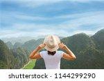 back view woman tourist... | Shutterstock . vector #1144299290
