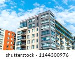 modern condo buildings with... | Shutterstock . vector #1144300976