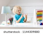 child doing homework at home.... | Shutterstock . vector #1144309880