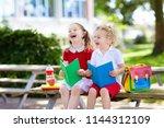 children go back to school.... | Shutterstock . vector #1144312109