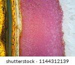 pink lake western australia... | Shutterstock . vector #1144312139