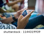 boy hand playing games  with... | Shutterstock . vector #1144319939