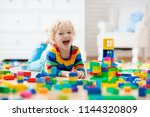 child playing with colorful toy ... | Shutterstock . vector #1144320809