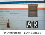 a hand painted air sign on the... | Shutterstock . vector #1144328693