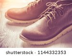 close up vintage leather shoes... | Shutterstock . vector #1144332353