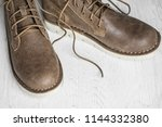 close up vintage leather shoes... | Shutterstock . vector #1144332380