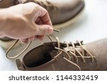close up vintage leather shoes... | Shutterstock . vector #1144332419