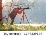 photographer taking photo with... | Shutterstock . vector #1144339979