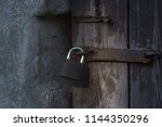 closeup a a wooden gate closed... | Shutterstock . vector #1144350296