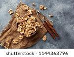 walnut kernels in clay bowl.... | Shutterstock . vector #1144363796