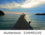 sunset at the bridge in the sea | Shutterstock . vector #1144401143