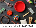 Stock photo flat lay composition with accessories for dog and cat on wooden background pet care 1144432949