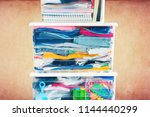 things packed plastic container ... | Shutterstock . vector #1144440299