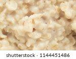 boiled oat porridge  macro... | Shutterstock . vector #1144451486