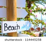 """""""Beach"""" sign pointing at beach - stock photo"""