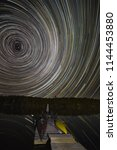 star trails in the night sky... | Shutterstock . vector #1144453880