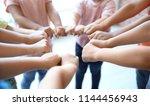 little children putting their... | Shutterstock . vector #1144456943