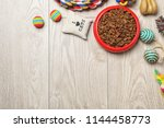 bowl with food for cat or dog... | Shutterstock . vector #1144458773