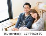 couple full of affectionate... | Shutterstock . vector #1144463690