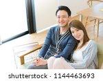 couple full of affectionate... | Shutterstock . vector #1144463693