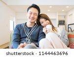 couple full of affectionate... | Shutterstock . vector #1144463696