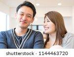 couple full of affectionate... | Shutterstock . vector #1144463720