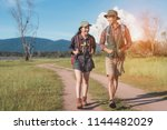 hikings couple asian walking... | Shutterstock . vector #1144482029
