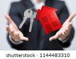 house in hand | Shutterstock . vector #1144483310