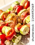 closeup of grilled shashliks  | Shutterstock . vector #1144492469